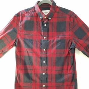 Buttoned up red w/ blue checkered casual shirt.